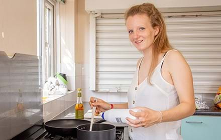 A homeless young woman supported by Centrepoint with her new kitchen utensils.