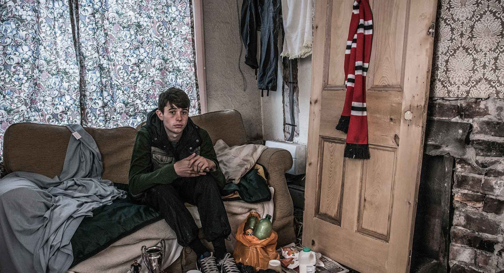 A young person sits in their front room. Add your name to Centrepoint's handraiser if you agree Universal Credit should not be making youth homelessness work.