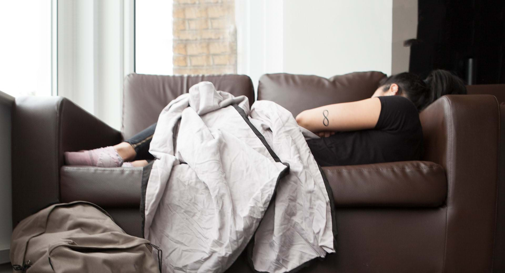 A girl sofa surfing who can access support from Centrepoint Helpline on 0808 800 0661.
