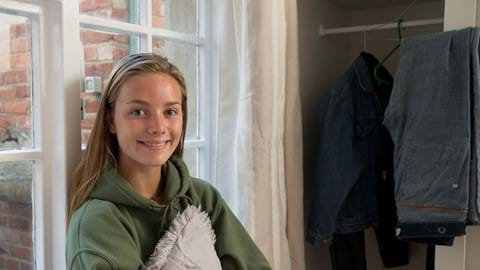An image of Abi, a homeless young person who was helped by Centrepoint. She lived in a Centrepoint sponsored room and is now excited about her future.