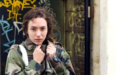 Girl wearing a military jacket.