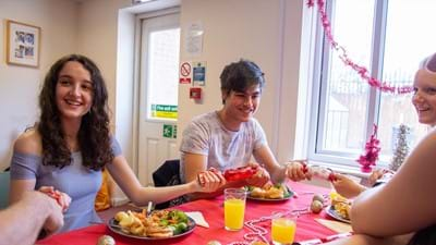 Young people enjoying their Christmas dinner.