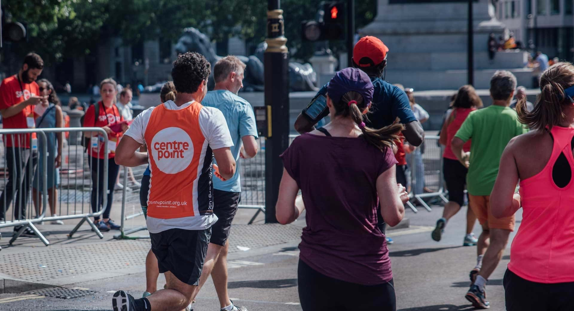 A participant at the British 10k runs for the charity Centrepoint.