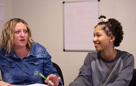 Teenage girl talks with her councillour. With your help, we can help give homeless young people a future
