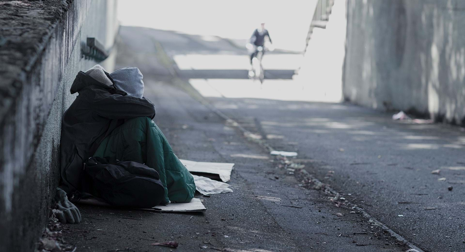 An image of a homeless and cold young person out on the streets.