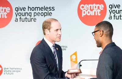 HRH The Duke Of Cambridge presents a young person with a Centrepoint award