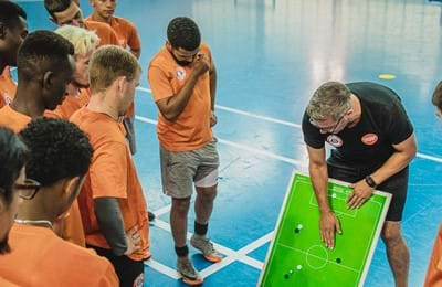 Craig McManus, Centrepoint's Senior Development Officer, leads a street football training session for homeless young people.