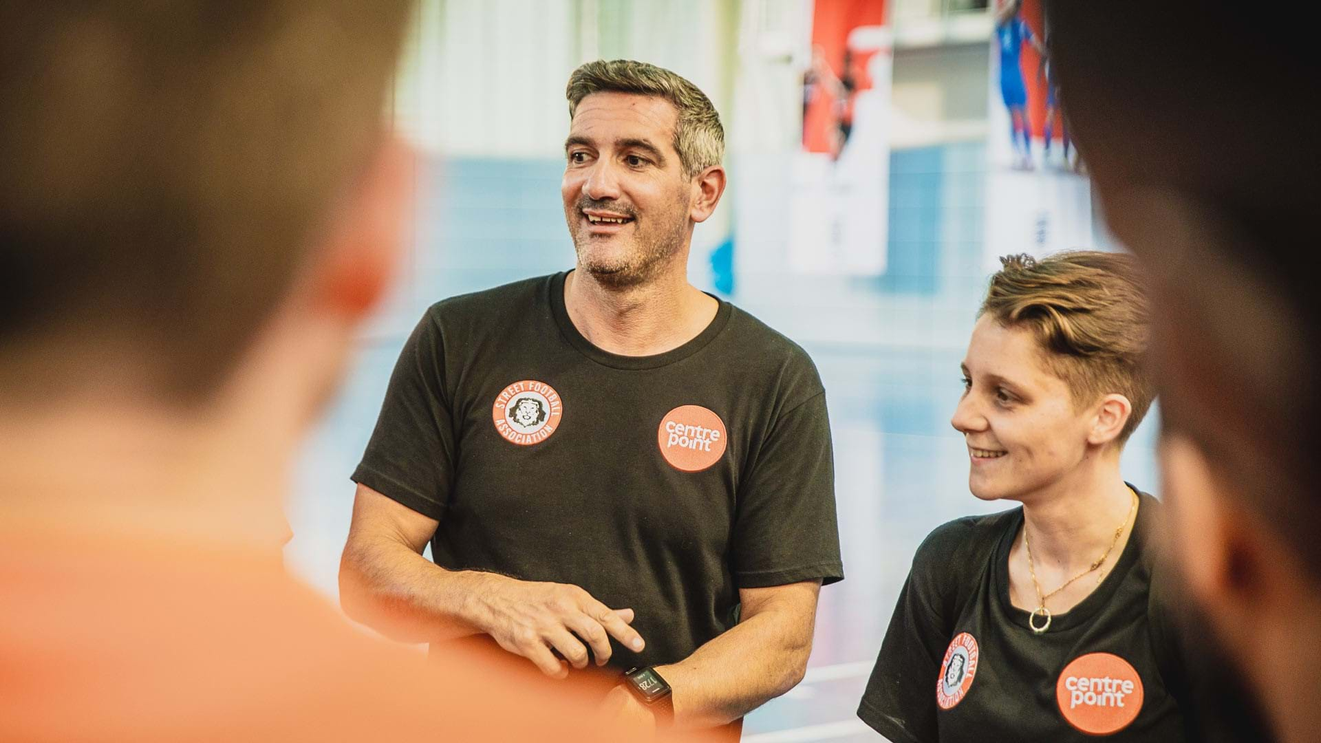 Becca, a Centrepoint Team England volunteer coach, with Craig, Centrepoint staff, at St George's Park, Burton.